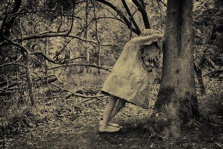 Weeping Girl Against Tree