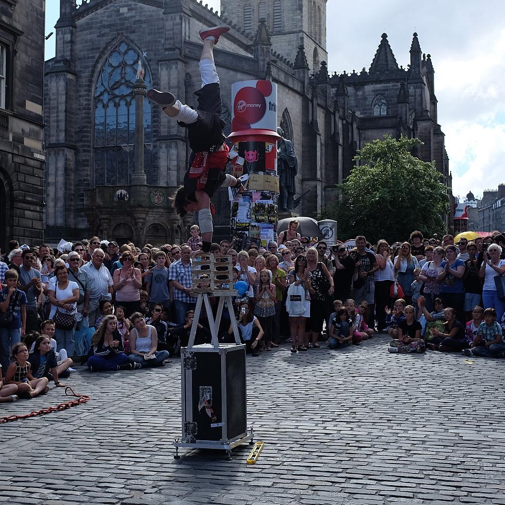 AD DJ doing crazy handstand